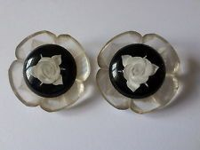 A pair of vintage Reverse Carved Lucite floral buttons