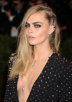 Cara Delevigne's sexy side braid looks great with a side part and long hair.