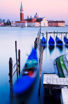 Gondolas point the way to San Giorgio Maggiore - one of the most famous islands in Venice, Italy