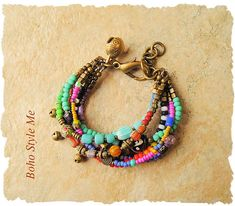 This colorful six strand bracelet is created using colorful trade beads, an artists palette of tribal matte glass beads, chevron beads, African trade beads, Czech glass beads, gooseberry beads, Picasso aged beads, gypsy brass bells and a Nepal brass bell charm. This bracelet is finished