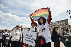 Activists of the LGBT community hold rainbow flags as they demonstrate through the main square in Pristina on May 17, 2016, as part of a first Gay Pride parade to seek acceptance and respect of their rights in a conservative society.