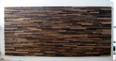 This gorgeous rustic wood wall décor is artistically handmade from reclaimed wood pieces in various thicknesses and lengths, stained in rich and varying shades of brown for a beautiful contrast. It can hang either vertically or horizontally, making it ideal for over a fireplace mantle