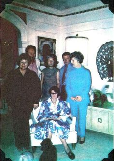 Various members of the Presley clan gathered in the living room at Graceland. Looks like Elvis' aunt Delta, Vernon, Vester and grandma Dodger sitting in the chair. Not sure who the other 3 are.