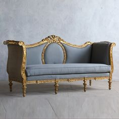 Splendid+vintage+Italianate+daybed+in+bright+warm+weathered+gilt+with+slate+blue+upholstery+on+the+front+and+burlap+on+the+back.+Floral+carvings+accent+the+oval+cutout+in+the+back.+42H+x+85W+x+29DSeat+Height:+19Arm+Height:+38Circa:+1920    Return+Policy:  This+item+is+not+eligible+for+returns+or+exchanges+so+please+make+sure+to+look+over+the+pictures+and+ask+questions+before+purchasing+this+beautiful+piece.