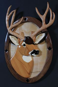 This Mule Deer Intarsia Sculpture measures 19 tall by 13 wide and is approximately 3/4 thick. Crafted from Peruvian Walnut, Black Walnut, Cedar, Gaboon Ebony, Aspen, Curly Maple, and White Limba. This piece of collectible wildlife art offers a lifetime of enjoyment. No paints, stains, or dyes are used, which makes for easy care - just dust and wax as needed.    The Rocky Mountain Muley is the largest of the deer and is easily distinguished from the whitetail by its large ears, which resemble…