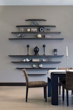 Simple dining room with great shelving, grey walls and wood flooring