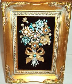 Vintage Jewelry Crafts Vintage Framed Jewelry Blue and Gold by DazzlingJewelryArt on Etsy - A sweet bouquet of rhinestone and blue stone vintage jewelry. In a 4 by 6 frame on black velvet. One of a kind. Costume Jewelry Crafts, Vintage Jewelry Crafts, Recycled Jewelry, Vintage Jewellery, Silver Jewellery, Vintage Brooches, Antique Jewelry, Jewelry Frames, Jewelry Tree