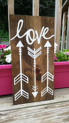 Accent your home with this beautiful Hand Painted Natural Wooden Love with Arrows Sign!  Approximately 14.5 x 7  Stained Dark Walnut Wood Color