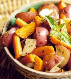Five Herb Roasted Carrots and Potatoes - A mix of chives, oregano, Italian parsley, rosemary, and sage make this side dish wonderfully fragrant and irresistibly delicious.