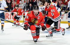 Jonathan Toews of the Chicago Blackhawks reacts in front of Andrew Shaw after scoring against the Nashville Predators during game six of their playoff series Saturday in Chicago. The Blackhawks won 4-3 to eliminate the Predators.
