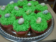 EASTER CUPCAKES. Strawberry Cake Mix and Tinted Cream Cheese Icing - Malted Milk Ball Eggs - so easy and so impressive.