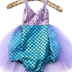 Adorable mermaid tutu outfit for a beautiful mermaid.  Everyone needs to have a mermaid party this summer!  ✨  #mermaidparty #mermaidfirstbirthday #mermaidcostume #mermaiddress #mermaidfirstbirthdayoutfit #mermaidtutu