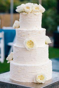 Simple white wedding cake // photo by http://www.pure7studios.com, via ...