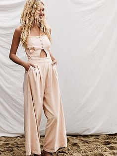 Marbella Cutout One Piece | Linen-blend jumpsuit featuring a cutout at the midriff and sultry open back. Button detail at the front and adjustable straps with elastic waist makes for an easy, effortless fit. Hip pockets and wide leg silhouette.