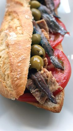 Anchovy, tuna, olive and tomato sandwich. (Bocadillo de tomate, anchoas, atun y aceitunas. Spanish Dishes, Spanish Tapas, Spanish Food, Antipasto, Cooking Ingredients, Tacos, Tostadas, Mediterranean Recipes, C'est Bon