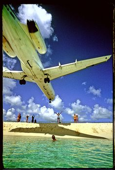 from st maarten airport (Juliana), Sun Set Beach, Maho Bay. I love the person arms raised...flying is amazing.