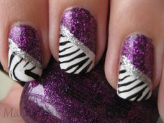 Glittery purple, silver with black and white tiger striped diagonal French tips! :)