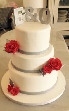 Red roses and silver wedding cake.