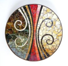 Large dish, measuring 45 cm / ~ 18 in diameter. Made with hand cutted stained glass and unglazed porcelain ceramic tiles on bamboo dish. Colors: