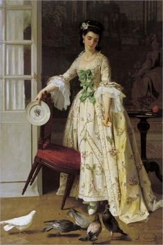 Feeding the pigeons whilst holding a 'Chine de Commande' armorial dinnerplate by Joseph Caraud