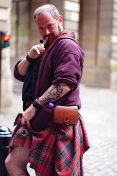"""This pin is from a website called """"Sight and Sounds of Edinburgh"""" and it is actually a touring company that I have been on many times! The reason this picture is interesting to me is it is tradition for men not to wear underwear under the kilts and that is why he is posing like this. It was recently published June 24, 2013. This pin will be helpful in my wedding traditions part of my speech when I explain how every man on my side of the family will wear a kilt to my wedding."""