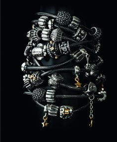 PANDORA BRACELETS With Loads of Oxidized Charms.