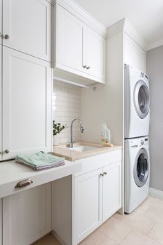 Laundry room using White glass subway tile. Gorgeous, modern, laundry room