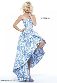 Sherri Hill 51097 is a strapless prom dress with a unique print and high low hem.