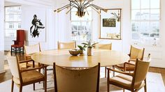 Designer Crush: Cliff Fong// California eclectic, midcentury modern, bright white room, round dining table, brass chandelier