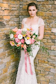 Anna Campbell Couture gown and beautiful peony bouquet