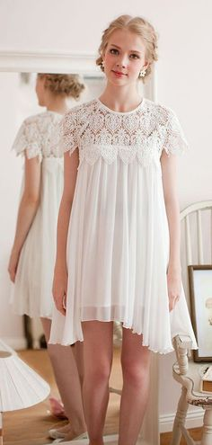 A short swing dress is flirty and feminine for a rehearsal dinner or reception.