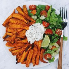 "thrivingonplants: ""Sweet potato fries, salad & home-made cashew sour cream Baked the potatoes in my air fryer (life saver… esp for no oil baking!) , added in some pepitas and sesame seeds from..."