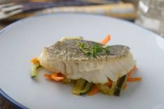 Baked cod on vegetable bed