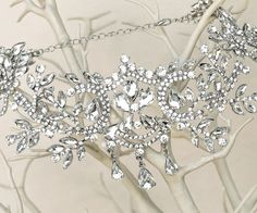 This dramatic and glamorous silver rhinestone bridal forehead hair piece is for the exotic bride or the bride who really wants to make a statement. Great quality and absolutely stunning!