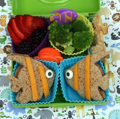 How deliciously beautiful does this lunch look?!  Remember, you don't have to make this everyday.  How about once every few weeks?  Your child will squeal with delight and we promise you they will gooble it all up! All you need are a few large, colorful cupcake liners and a fish cookie cutter.
