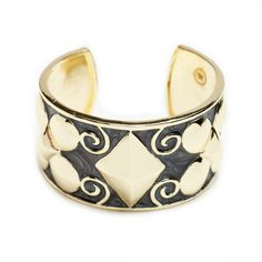 We love the artsy feel of the Stacia bangle. Raised circles and pyramids meet with whimsical swirls for playful contrast and an all-around stylish appeal. Pair with simple silver bangles for an even more carefree vibe.  Find it on Splendor Designs