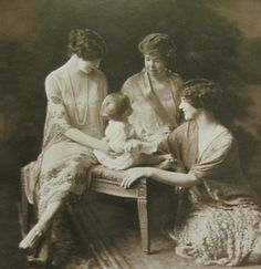 (From L. to R.) Gertrude Whitney, Mrs. C. Vanderbilt II and Gertrude's daughter, Flora Miller; all centered around Flora's baby daughter.