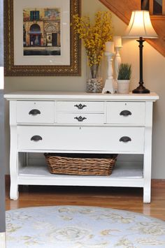 Paint a dresser; take out bottom drawer, add baskets and there is an awesome accent table