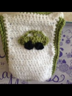 Crotchet baby bib with crotchet car appliqué