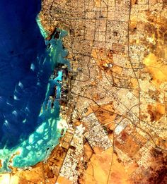 """SAUDI ARABIA, JEDDAH (FEATURING RED SEA) """"There's so much information in a rich space image. You can see the geology and the geography and the history. You can see your own imprint; you can notice things, like how a coastline cuts in."""" Combining Art And Science (And Taking Amazing Photos) From Rockstar Astronaut Chris Hadfield 