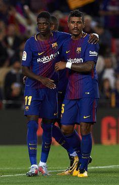 Ousmane Dembele (L) and Paulinho of Barcelona celebrate after the La Liga match between Barcelona and Espanyol at Camp Nou on September 9, 2017 in Barcelona.