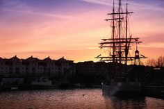 A sunset view of the Bristol Floating Harbour with one very large sailing ship parked near the Lloyds TSB building