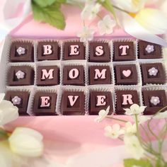 Mother's Day chocolate and card. Tell her she's the best Mom ever with 18 delicious and decadent chocolate squares. Each chocolate treat has a letter to spell out how much you love Mom. This unique gift of 18 chocolates, is presented in a white gift box, with your choice of 5 message cards, and tied with a pretty ribbon.