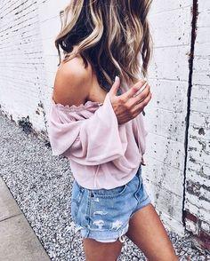 Pink off the shoulder top & denim shorts.