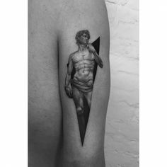 Dotwork style Michelangelo's David tattoo on the back of the right arm.