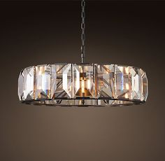 """RH's Harlow Crystal Chandelier 43"""":Inspired by a German chandelier from the 1970s, our fixture evokes the boldness and glamour of the era. A band of faceted crystal glass prisms reflects and refracts the light, capturing the essence of emerald-cut diamonds."""
