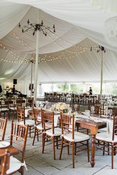 Romantic tented wedding decor: http://www.stylemepretty.com/new-jersey-weddings/andover-township/2016/01/08/family-oriented-romantic-new-jersey-inn-garden-wedding/ | Photography: Julia Elizabeth - http://www.julia-elizabeth.com/