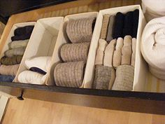 "Taming Sock Drawer: ""Fold socks instead of balling them up...it puts less strain on the elastic and looks tidier.  Roll stockings and put them in a smooth sided organizer that won't snag them and cause them to tear. (I used clear plastic condiment trays from the dollar store)"""