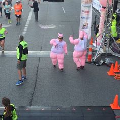 The Flying Pig Mascots dance at the finish line at U.S. Bank Arena during the Flying Pig Marathon, downtown, Cincinnati, Sunday, May 3, 2015. The Enquirer/Jennifer Koehler.
