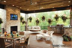 #Housetrends' most popular photos of 2017: #9 This #Cincinnati porch has it all -- a dining area, an outdoor kitchen and a big screen television that is great for watching fall football games while the fire roars just beneath the screen.